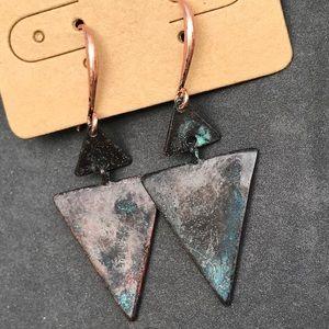 Earrings. Distressed metal